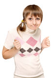 Young beautiful girl makes faces Stock Photography