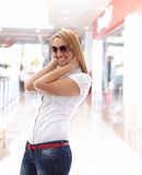 Young beautiful girl in the mall Stock Photography