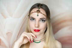 Young beautiful girl, massive gold accessory necklace royalty free stock image