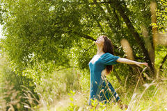 Young beautiful girl on a meadow Stock Image