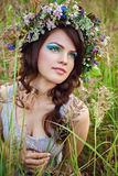 Young beautiful girl at the meadow Royalty Free Stock Photo