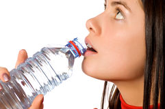 Young beautiful girl with mineral water Stock Photography