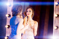 Young beautiful girl in the mirror in a nightclub. Beauty woman. Stock Images