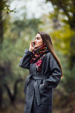 Young beautiful girl with mobile phone walking in the park Stock Image