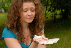 Young beautiful girl with money. Young beautiful girl with Russian money - Rubles royalty free stock photos