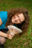Young beautiful girl with money. Young beautiful girl with Russian money - Rubles royalty free stock photography