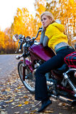 Young beautiful girl on motorcycle Royalty Free Stock Image