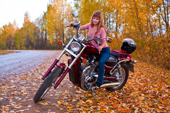 Young beautiful girl on motorcycle Stock Photography