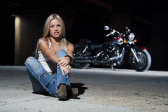 Young beautiful girl with a motorcycle Royalty Free Stock Image