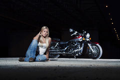 Young beautiful girl with a motorcycle Stock Photo