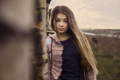 Young beautiful girl in the nature. Sun is shining. she is dreaming Royalty Free Stock Photography