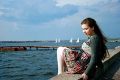 Young beautiful girl near the sea Royalty Free Stock Images