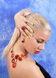 Young beautiful girl with a necklace on a naked shoulder on an a Stock Photography