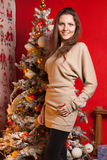 Young beautiful girl in the New Year decorations on the background of wallpaper with colorful people Royalty Free Stock Images