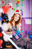 A young, beautiful girl in a New Year`s cap, a future mother dre royalty free stock photo