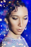 Young beautiful girl with a New Year's make-up on New Year's party. Royalty Free Stock Photography