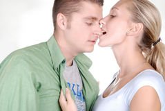 Young beautiful girl nibbling her boyfriend Royalty Free Stock Photography