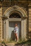 Young beautiful girl at the old door near the Villa Pamphili in Rome, Italy stock images