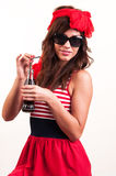A young beautiful girl old-fashioned, drink soda through a straw Royalty Free Stock Photo