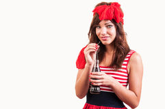 A young beautiful girl old-fashioned, drink soda through a straw Royalty Free Stock Photos