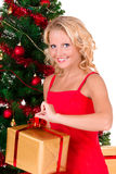 Young beautiful girl opening Christmas box Stock Image