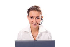 Young beautiful girl operator with laptop. On white background stock photography