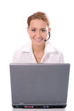 Young beautiful girl operator with laptop Stock Images