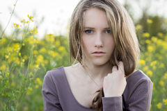 Young beautiful girl outdoor portrait, emotional look Stock Photography