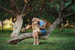 Young beautiful girl with pekingese Royalty Free Stock Photo