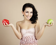 Young beautiful girl with pepper and apple Stock Photos