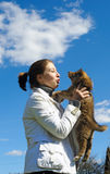 Young beautiful girl pets a puppy Stock Photography