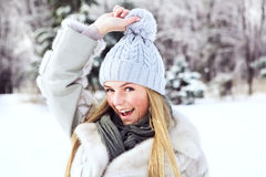 The young, beautiful girl, is photographed in the cold winter in park Stock Photos