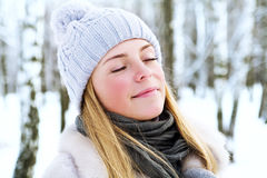 The young, beautiful girl, is photographed in the cold winter in park Royalty Free Stock Images