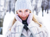 The young, beautiful girl, is photographed in the cold winter in park Royalty Free Stock Image