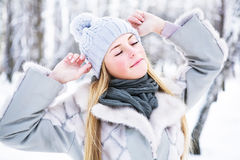 The young, beautiful girl, is photographed in the cold winter in park Royalty Free Stock Photos