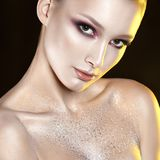 Young beautiful girl with pink make-up and glitter in decolletag Royalty Free Stock Image