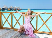 Young beautiful girl in pink sundress on platform Stock Images
