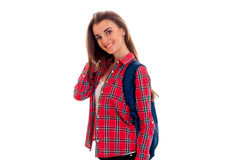 Young beautiful girl in Plaid Shirt looks into the camera and smiling Stock Photography