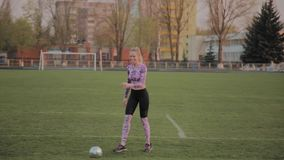 Young beautiful girl playing with a ball at the stadium. Young beautiful girl playing with a ball at the stadium stock video