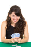 Young beautiful girl playing cards Stock Photography
