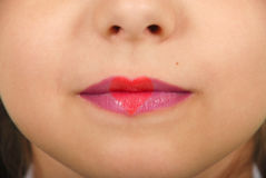 Young beautiful girl playing with heart drawing on lips. Valentines day beautiful love make-up royalty free stock photos