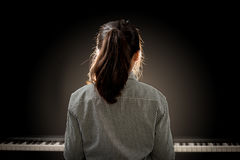 Young beautiful girl playing the piano Stock Photo