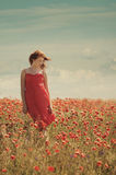 Young beautiful girl in poppy field Royalty Free Stock Photos