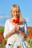 Young beautiful girl in the poppy Royalty Free Stock Images