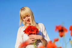 Young beautiful girl in the poppy Royalty Free Stock Image