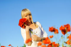 Young beautiful girl in the poppy Stock Photography