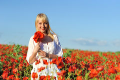 Young beautiful girl in the poppy Royalty Free Stock Photos
