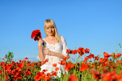 Young beautiful girl in the poppy Stock Photo
