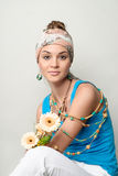 Young beautiful girl portrait. Flowers, turban and bijouterie Royalty Free Stock Images