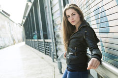 Young and beautiful girl posing against graffiti Royalty Free Stock Photos